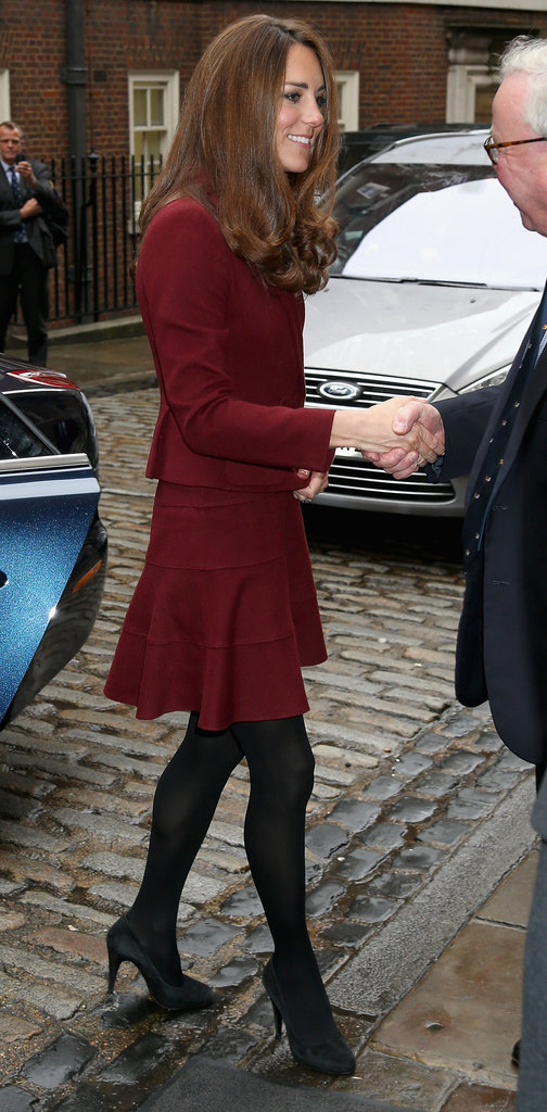 Kate Middleton arrived in a red suit.