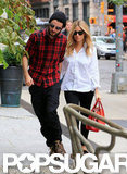 Tom Sturridge held Sienna Miller's hand as they walked into their hotel in NYC.