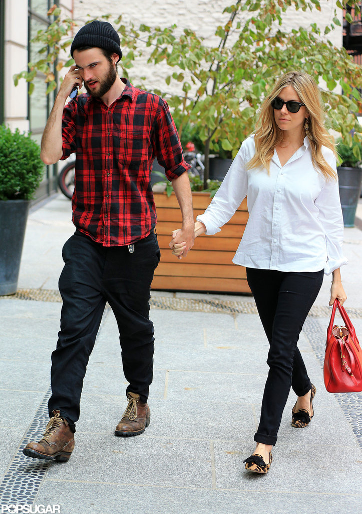Sienna Miller held Tom Sturridge's hand as they walked into the Crosby Street Hotel in NYC.