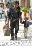 Little Naviyd clutched a blue basketball while he and Usher arrived at their New York City hotel in May 2011.