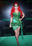 Kim Kardashian was dressed as Poison Ivy at the Midori Green Halloween party in 2011.