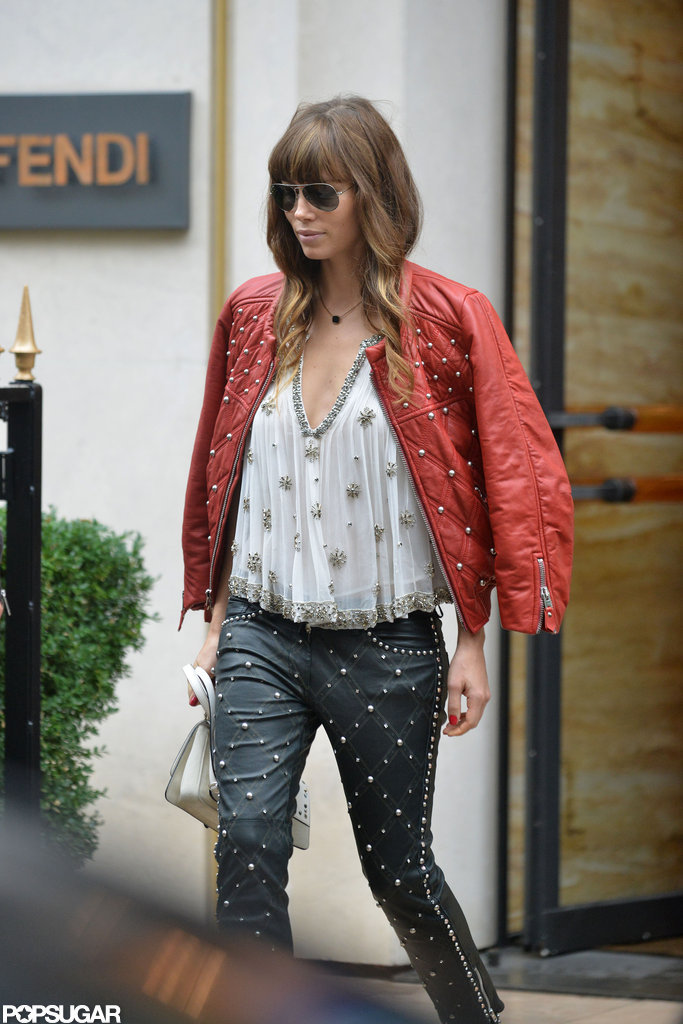 Jessica Biel paired a red leather jacket with studded black leather pants to stop by Fendi in Paris.