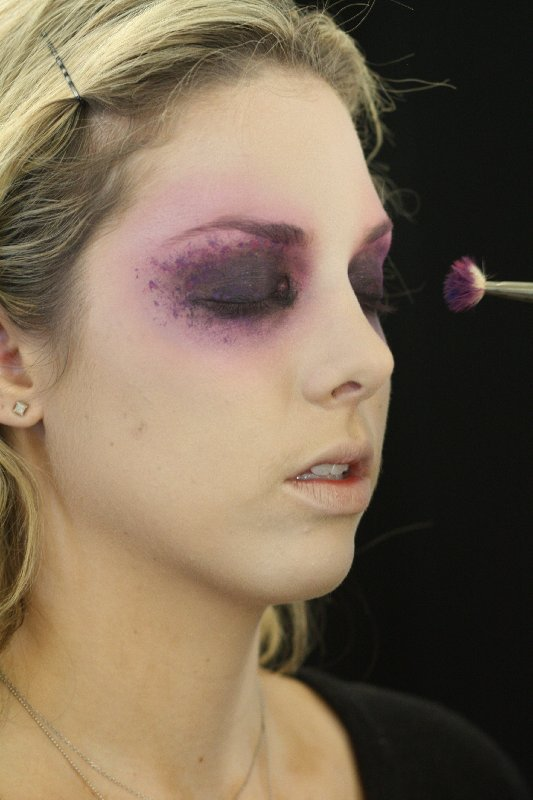 "To create the purple flecks around the eyes, use highly pigmented gel eyeliners. Zizzo placed Chromaline ($20) in Process Magenta and Marine Ultra on the back of her hand, then used a distressed brush to dot on color. ""Mess up a cheap brush — any old paintbrush you have knocking around will do,"" she says. ""This way, the spots look more organic,"" she says."