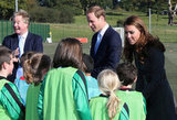 Prince William, Duke of Cambridge, and Catherine, Duchess of Cambridge, spoke to young footballers during the official launch of The Football Association's National Football Center.