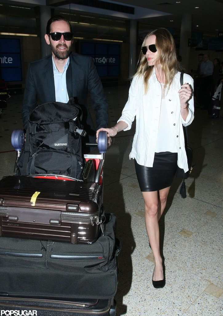 Kate Bosworth and Michael Polish made their way through the airport.