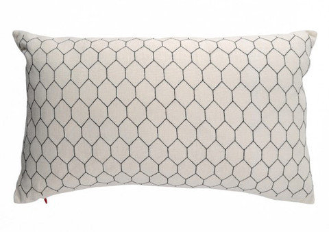 This Chicken Wire Cushion ($180) steals the material's honeycomb pattern but is soft enough to curl up with.