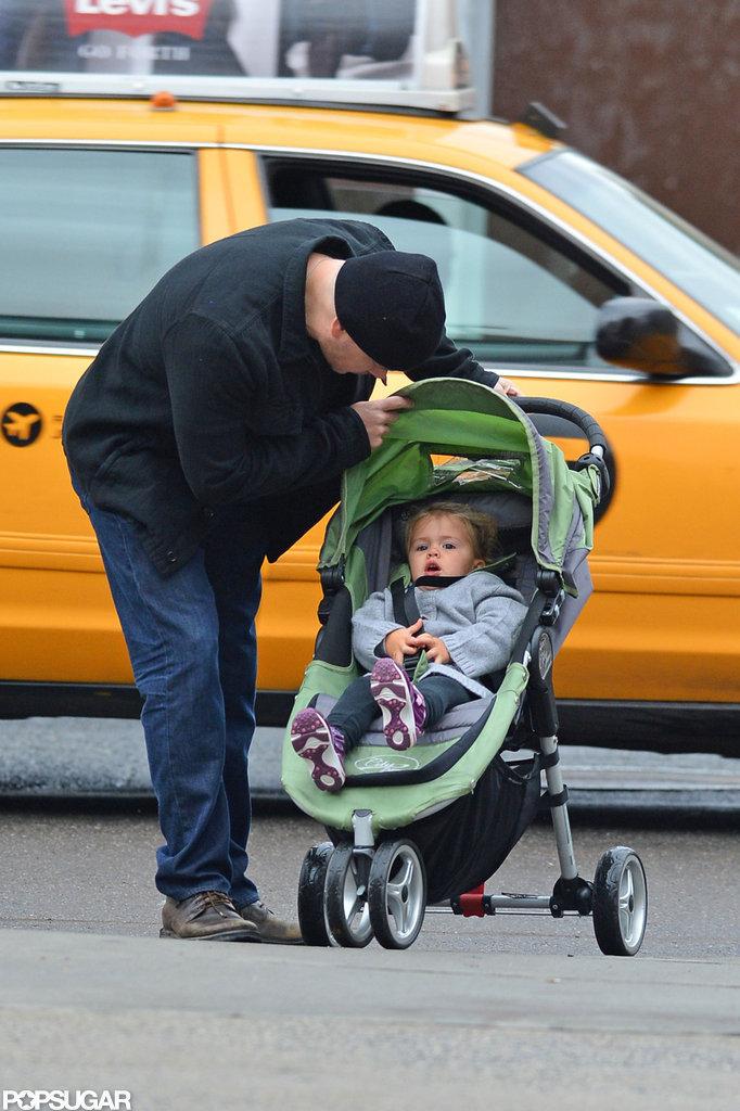 Matt Damon checked on Stella Damon in her stroller during their walk.