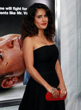 Salma Hayek carried a red clutch.