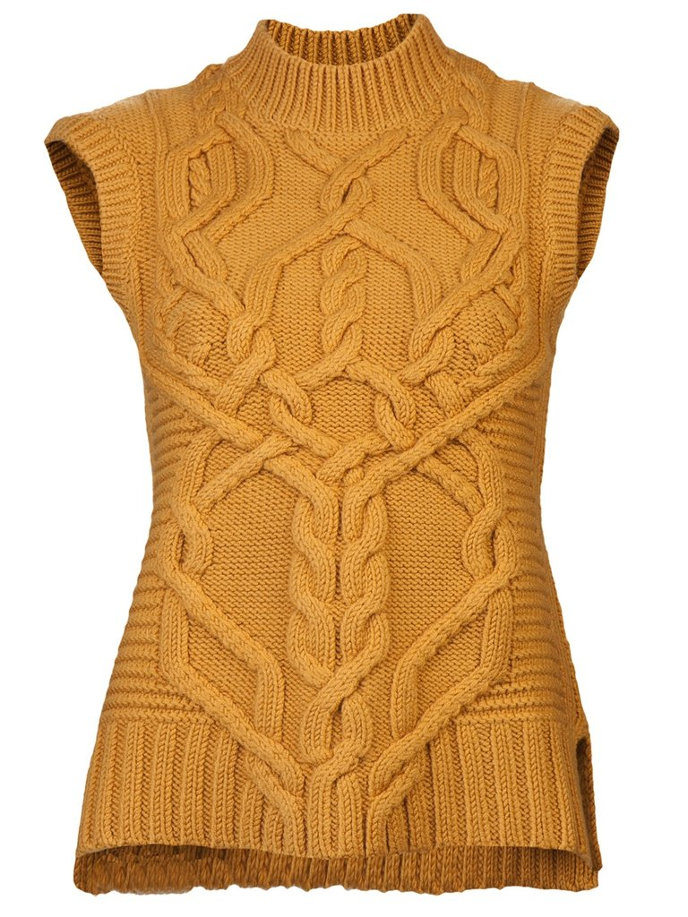 The rich mustard hue of Derek Lam's Knit Sweater Vest ($890) is perfect for Fall, and would look great against a leopard print belt.