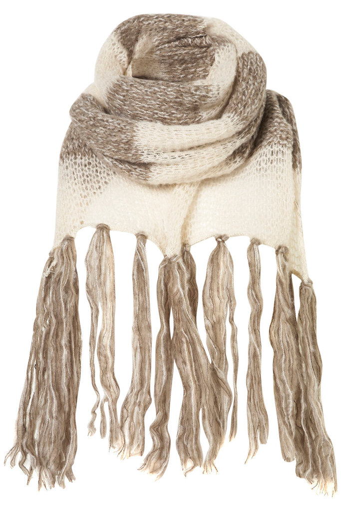 "This Topshop panel knit scarf ($32) has ""wrap me up and never take me off"" written all over it — plus, we can't get enough of the two-toned color detail."