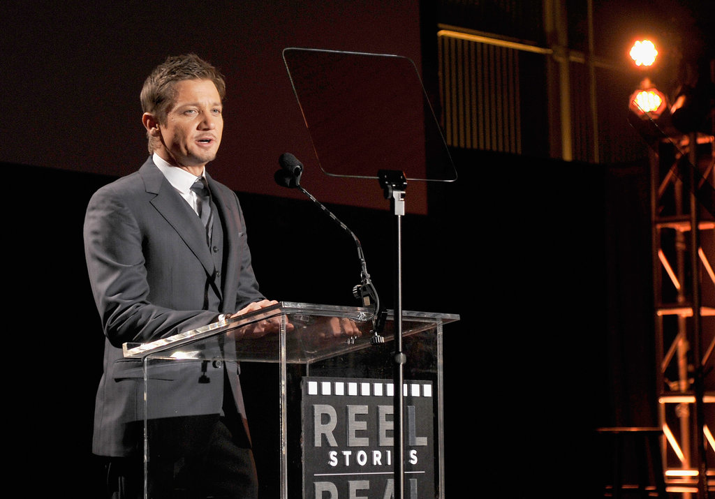Jeremy Renner spoke at the podium on stage.