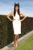 Jessica Gomes wore white Scanlan & Theodore with gold Celine heels and a lace headpiece.