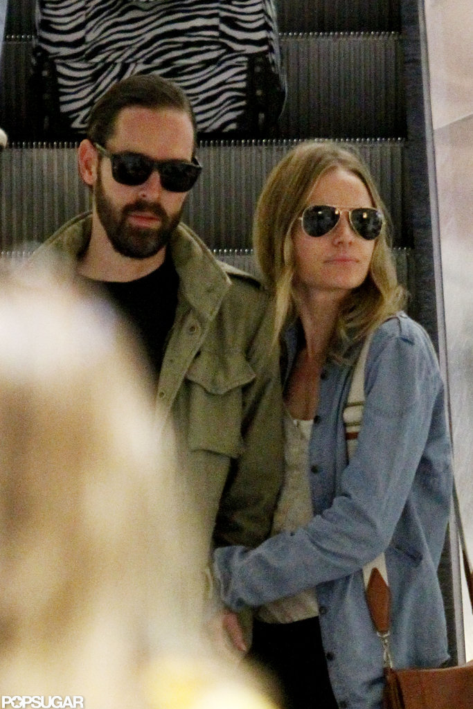 Kate Bosworth and Michael Polish rode down the escalator arm-in-arm.