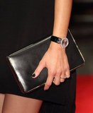 Paying close attention to Marion's add-ons, we love that the actress went sleek with a black Dior clutch (and dark nails to match), plus a jeweled but still edgy Chopard watch.
