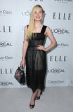 Elle Fanning wore a Spring 2013 Calvin Klein dress and Dolce and Gabbana bag at the Elle Women in Hollywood Awards in LA.