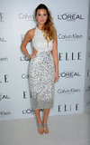 Whitney Port chose a curve-hugging, paillette-covered silver and white Asos cutout dress.
