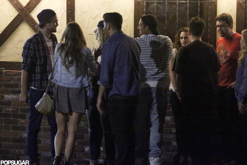 Robert Pattinson and Kristen Stewart met up with a group of friends.