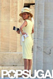 Kirsten Dunst donned a pale yellow dress and hat while filming in Greece.