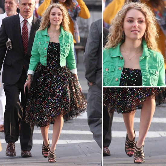 "Carrie styled a green denim jacket over her printed party dress with strappy black sandals, a few colourful bracelets, and her signature ""C"" necklace."