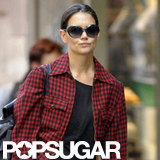Katie Holmes wore a red plaid jacket.