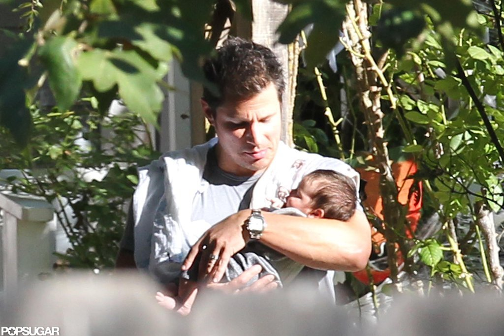 Nick Lachey carried baby Camden Lachey.