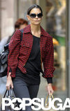 Katie Holmes carried three bags while she strolled through Manhattan.