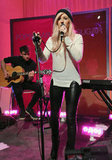 Ellie Goulding wore black leather pants and sky-high platforms for the performance.