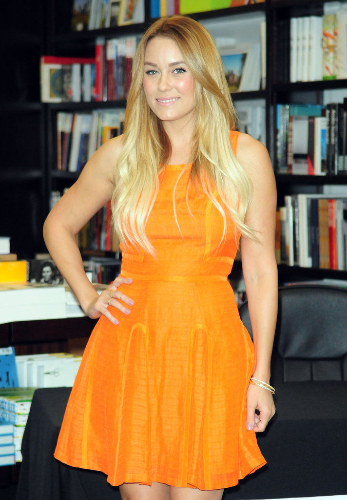 Lauren Conrad wore a bright orange dress at a bookstore in Miami.