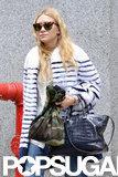 Ashley Olsen wore a white fur coat with stripes.