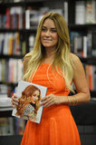 Lauren Conrad wore a bright orange dress for a book signing in Miami.