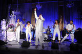 An all-white-clad band turned it up at the party.