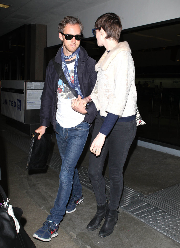 Anne Hathaway held hands and chatted with husband Adam Shulman in LA.