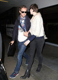 Anne Hathaway held hands with her husband Adam Shulman in LA.