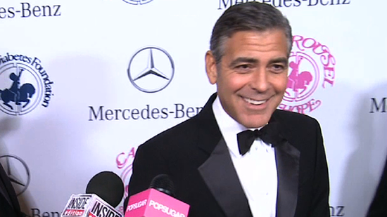 Video: George Clooney Breaks Into Song During a PDA-Filled Night With Stacy Keibler