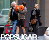Pregnant Claire Danes took pictures of Hugh Dancy carrying pumpkins in Toronto.
