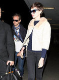 Anne Hathaway stepped out with husband Adam Shulman at LAX.