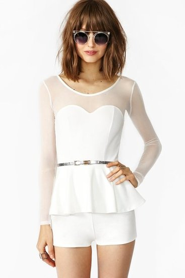 If you're in the mood for something short and sweet, look no further than Nasty Gal's Ivory Peplum Mesh Romper ($48).