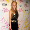 AnnaSophia Robb Wearing Gold Peplum Top
