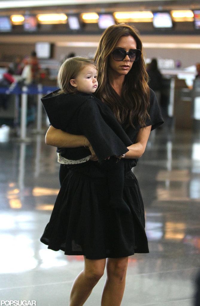 Victoria Beckham gave Harper Beckham a lift.