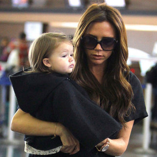 Victoria Beckham Carrying Baby Harper at JFK | Pictures