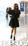 Victoria Beckham carried Harper Beckham through the airport.