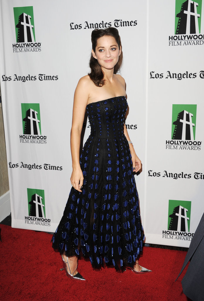 Marion Cotillard wore a strapless gown to attend the gala.