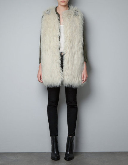 Zara's Faux Fur Applique Vest ($90) is perfect for parties — layer it over a sexy red or black minidress for a touch of bohemian chic.