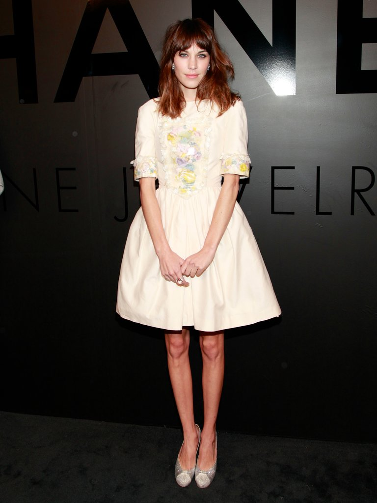 Alexa Chung looked sweet in a full-skirted Chanel dress. We love the longer sleeves and the added interest via floral appliques. We also love that Alexa lets the dress do the talking, adding in just a touch of sparkle and a pair of glittery pumps to complement the ultrafeminine style.