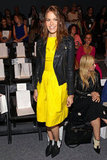 If you're looking for ways to counter the overt girlieness of a fit-and-flare shape, Mandy Moore is a perfect example. She styled her bright little yellow dress with a contrasting, tough-girl leather jacket and ankle boots, giving it an edgier makeover.