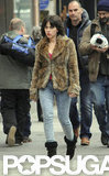 Scarlett Johansson sported a brunette wig and fur coat.