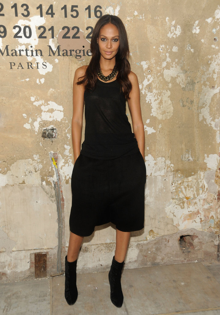Joan Smalls took the easy-chic approach in oversize shorts and a black tank, accessorized with a chain-link necklace and black ankle boots.