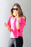 Alessandra Ambrosio stopped for a sip between photos.