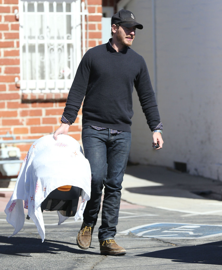 Will Kopelman held on to Olive's car seat as he left an LA restaurant.