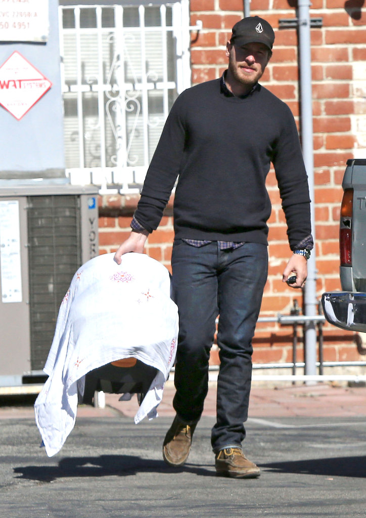 Will Kopelman carried baby Olive in her car seat.